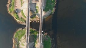 Drone aerial shot of two story rail bridge in Russia. Railway crossing over river with in iron bridge stock video