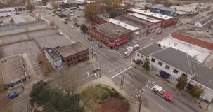 Aerial Bird`s Eye View of Traffic, Big Rigs and Trucks on City Streets of Raleigh NC. Drone Aerial video of Downtown City Streets of Raleigh with traffic stock footage