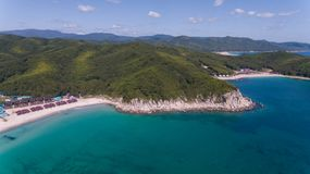 Drone aerial view from above on beautiful blue water bay on sunny day royalty free stock image