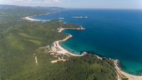 Drone aerial view from above on beautiful blue water bay on sunny day royalty free stock photography