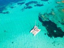 Drone aerial view of catamaran sailing boat in Maddalena Archipelago, Sardinia, Italy. stock image