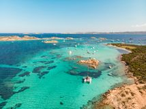 Drone aerial view of catamaran sailing boat in Maddalena Archipelago, Sardinia, Italy. royalty free stock image