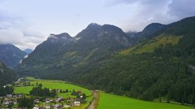 Drone aerial view - flying over Alps, Austria. Cloudy evening stock video footage