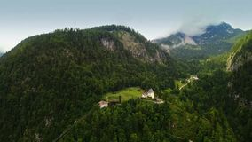 Drone aerial view - flying over Alps, Austria. Cloudy evening stock footage