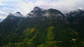 Drone aerial view - flying over Alps, Austria. Cloudy evening stock video