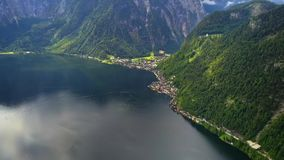 Drone aerial view - flying over Hallstatt, Austria. Drone aerial view - flying over Hallstatt in Alps, Austria, cloudy evening stock footage