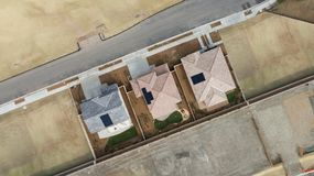 Drone Aerial View of Home Construction Site Final Stage. Drone Aerial View of a New Home Construction Site Final Stages Royalty Free Stock Images