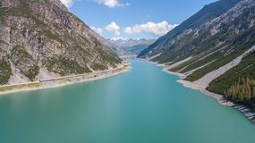 Drone aerial view of the Lake Livigno an alpine artificial lake. Italian Alps. Italy Royalty Free Stock Photography