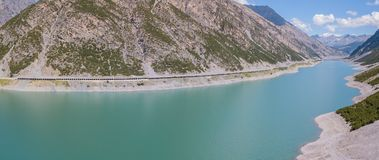 Drone aerial view of the Lake Livigno an alpine artificial lake. Italian Alps. Italy Royalty Free Stock Photo