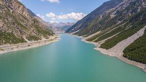 Drone aerial view of the Lake Livigno an alpine artificial lake. Italian Alps. Italy Stock Image
