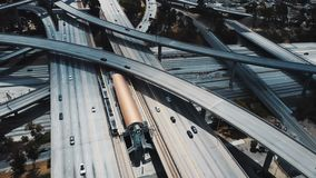 Drone aerial view of a large highway road intersection in Los Angeles, USA with complex system of junctions and bridges. stock video