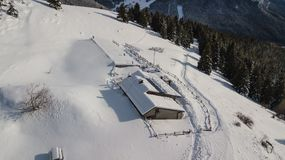 Drone aerial view of the lodge Cassinelli after a snow fall. Italian Alps.  Royalty Free Stock Photo