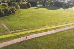 Drone aerial view of man running in Nemunas Island park, Kaunas, Lithuania royalty free stock images