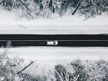 Drone aerial view of road in the snowy forest stock image