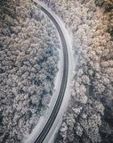 Drone aerial view of road in the snowy forest Stock Photography