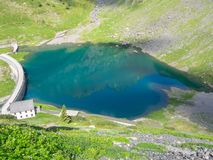 Drone aerial view of the small and lower Lake Barbellino an alpine artificial lake. Italian Alps. Italy. Summer time Stock Photos