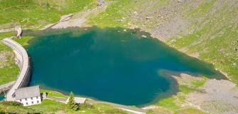 Drone aerial view of the small and lower Lake Barbellino an alpine artificial lake. Italian Alps. Italy. Summer time Royalty Free Stock Image