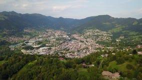 Drone aerial view to the villages of Leffe, Gandino, Casnigo, Peia and Cazzano Sant Andrea, located at Gandino Valley. Bergamo, Italy stock video