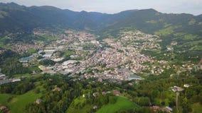 Drone aerial view to the villages of Leffe, Gandino, Casnigo, Peia and Cazzano Sant Andrea, located at Gandino Valley. Bergamo, Italy stock video footage