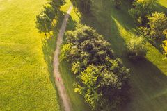 Drone aerial view of woman running in Nemunas Island park, Kaunas, Lithuania royalty free stock image