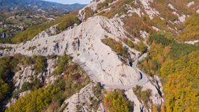 Drone aerial view of woods during the autumn season with warm colors. Drone aerial view of woods during the autumn season with warm colours Royalty Free Stock Photo