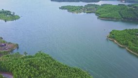 Drone Approaches Blue Wonderful Calm Lake with Islands. Drone approaches blue wonderful tranquil highland lake with small islands among green tropical jungles stock video
