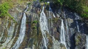 Drone Approaches Wonderful Waterfall Streaming on Rocks stock video footage