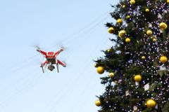 Drone on the background of the Christmas tree. Quadcopter shoots New Year`s video. Drone on the background of the Christmas tree. Quadcopter shoots New Year`s Royalty Free Stock Photography