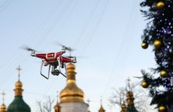 Drone on the background of the Christmas tree. Quadcopter shoots New Year`s video. Drone on the background of the Christmas tree. Quadcopter shoots New Year`s Stock Images