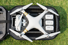 Drone in backpack on grass Royalty Free Stock Photography