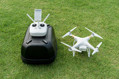 Drone and backpack on grass Royalty Free Stock Image