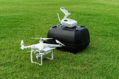 Drone and backpack on grass Stock Images