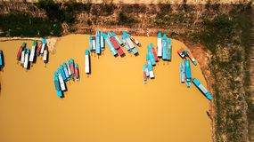 Drone birdeye Aerial view of boats in Siem-Reap Tonle Sap Cambodia. Drone Aerial view of boats in Siem-Reap Tonle Sap Cambodia Royalty Free Stock Image