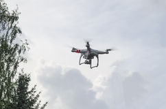 The drone in the blue sky flying stock photo