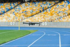 Dron with a camera in the stadium royalty free stock photo