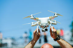 Drone with camera in male hands Stock Image
