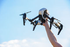 Drone with camera in man hand stock images