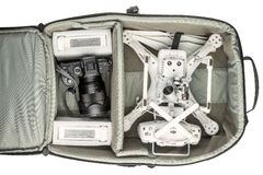 Drone and camera in photo backpack. Fort Collins, CO, USA - March 09, 2016:  Photographer's backpack with DJI Phantom 3 quadcopter drone,  a set of propellers Royalty Free Stock Images