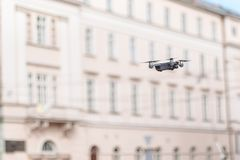 The drone with camera takes pictures of the sky stock photography