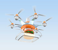 Drone carrying hamburger for fast food delivery concept Royalty Free Stock Image