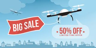 Drone carrying a shopping sale banner in the sky stock image