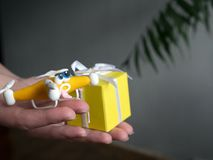 The drone Close up of quadrocopter with the parcel. tired stock image