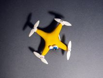 The drone Close up of quadrocopter with the parcel. tired royalty free stock images