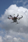 Drone in clouds. Drone flying in air with clouds Royalty Free Stock Photo