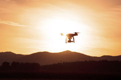 Drone concept. Drone flying in the sunset light Stock Photo