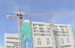Drone copter flying with digital camera.Drone with high resolution digital camera over construction site stock photos
