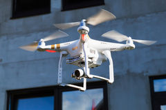 Drone copter observes construction site Royalty Free Stock Image