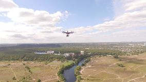 Drone copter UAV - aerial video shooting flying on eight propellers oktocopter. stock video