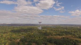 Drone copter UAV - aerial video shooting flying on eight propellers oktocopter. Video capture of professional oktocopter in the air with help of the other stock video
