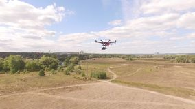 Drone copter UAV - aerial video shooting flying on eight propellers oktocopter. Video capture of professional oktocopter in the air with help of the other stock footage